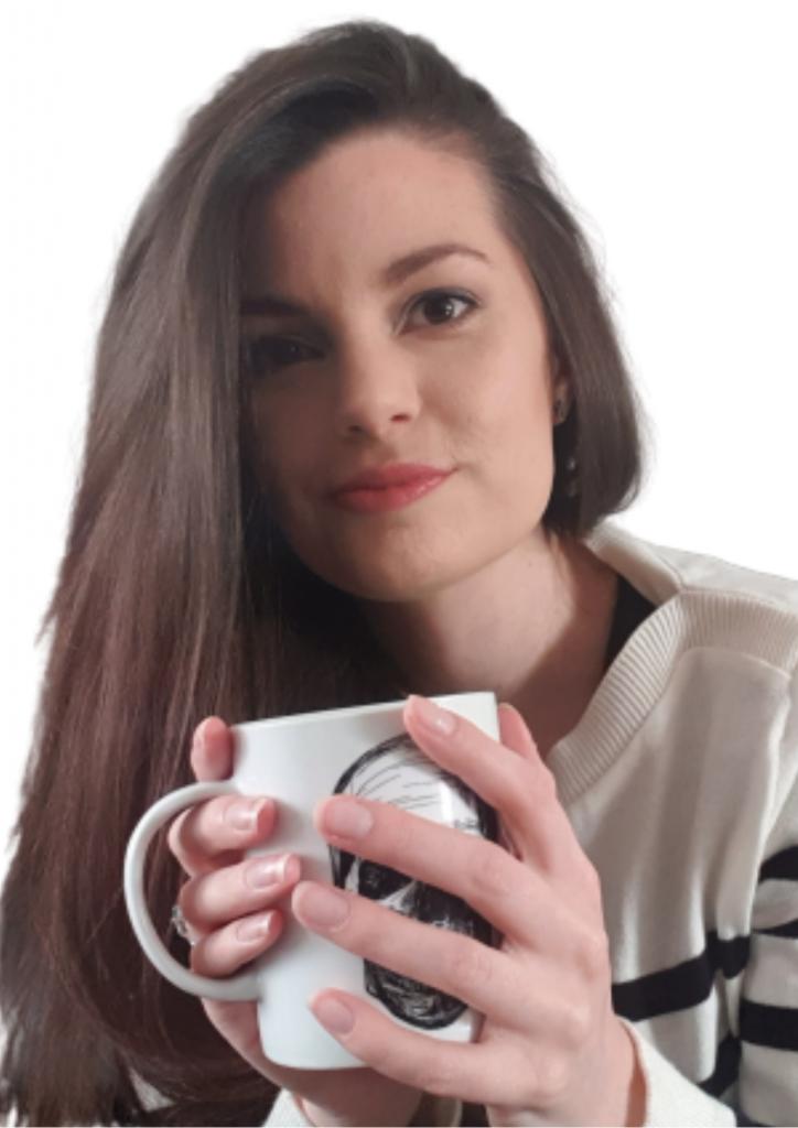 Woman holding a skull mug