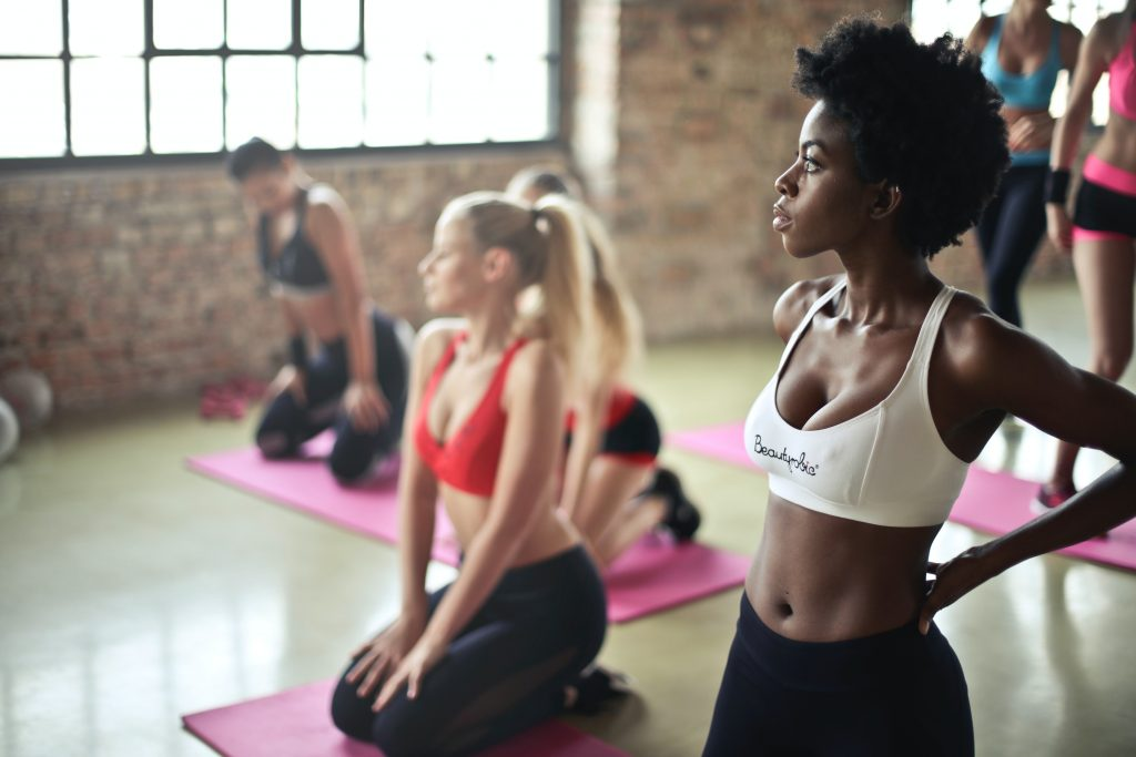 Ladies sitting on the floor of a yoga class