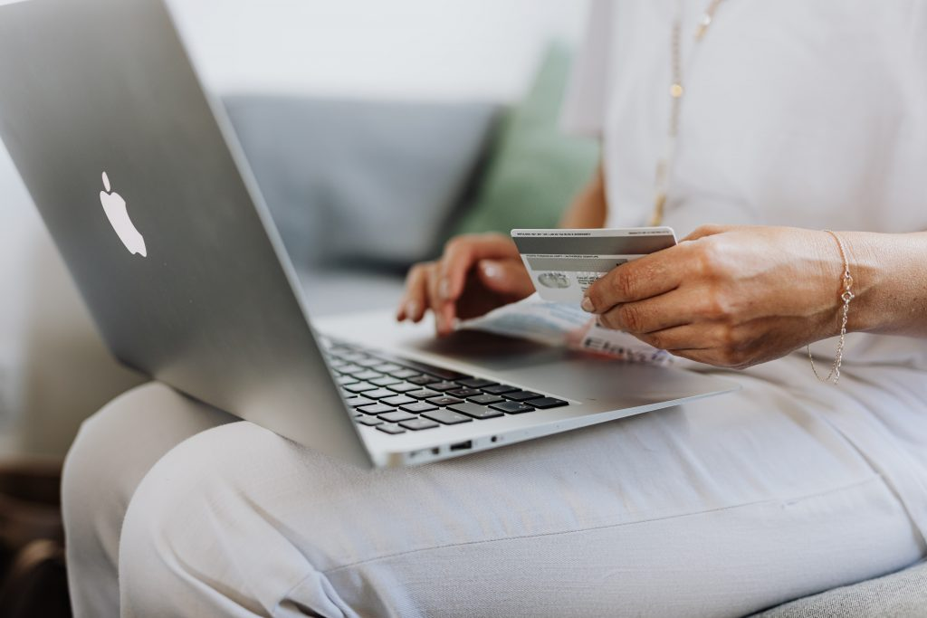 woman using laptop to make online purchase